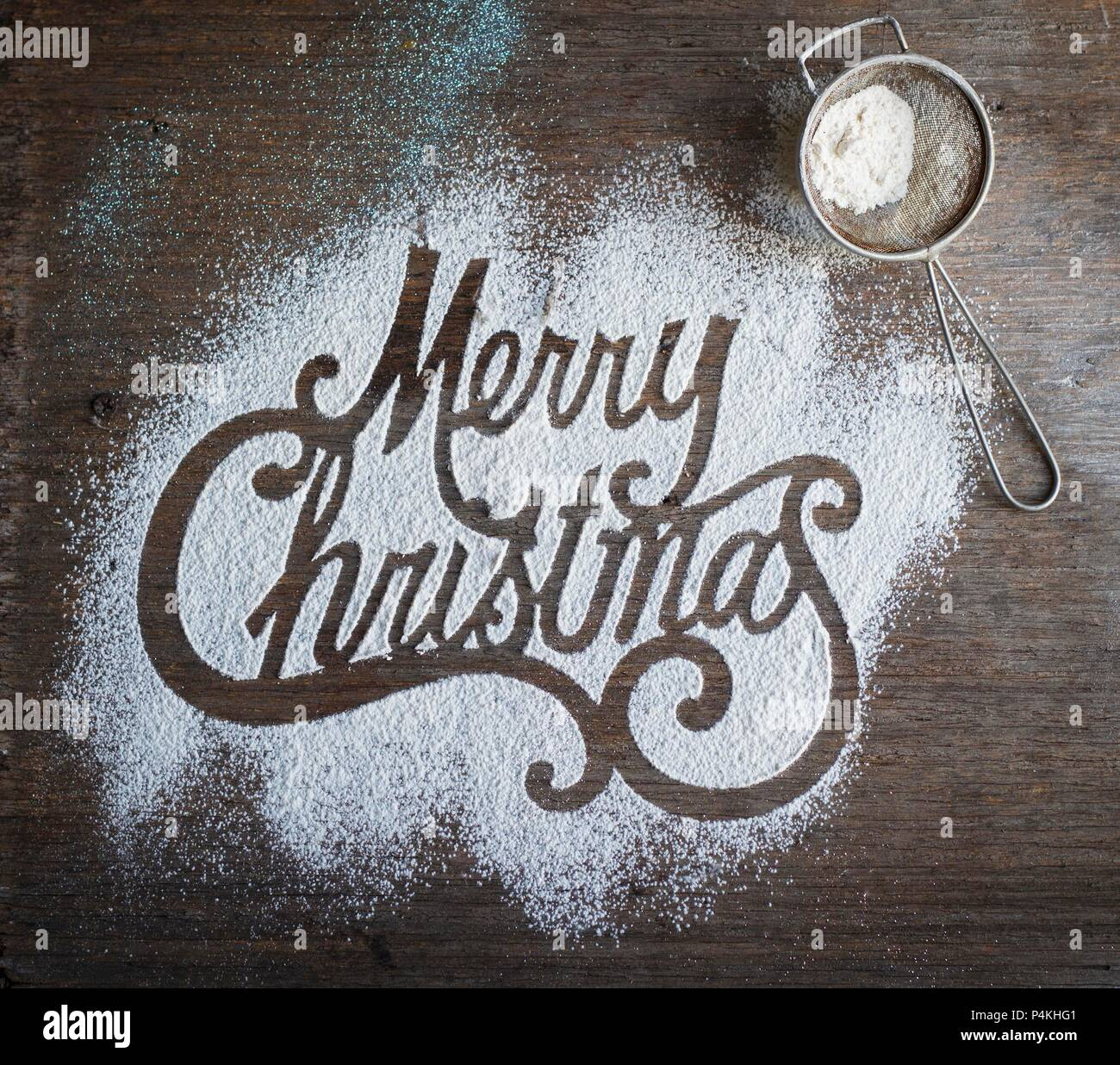 Merry Christmas written in icing sugar - Stock Image