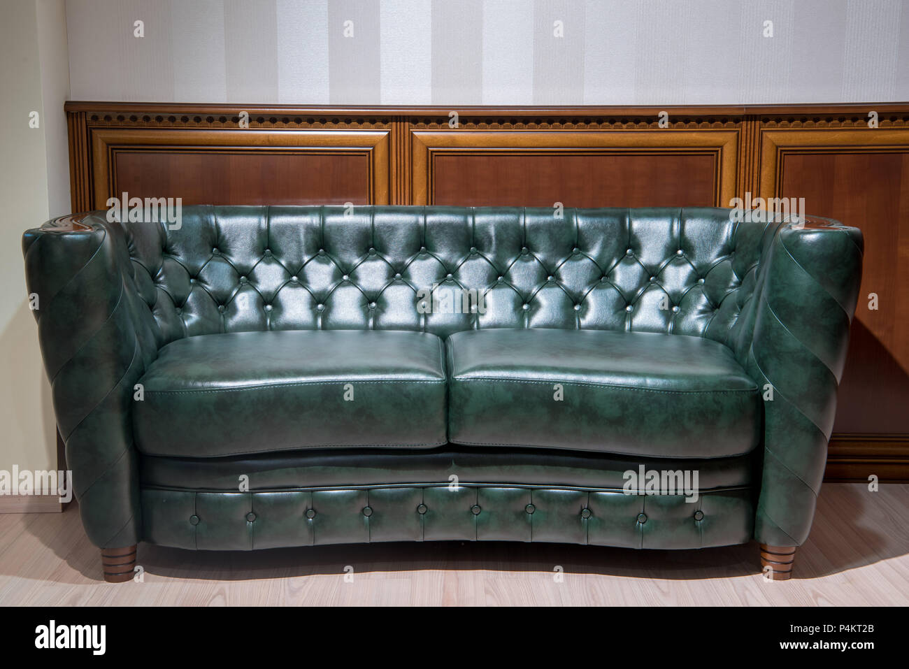 Surprising Green Leather Couch In Front Of Wall With Wooden Decoration Gmtry Best Dining Table And Chair Ideas Images Gmtryco