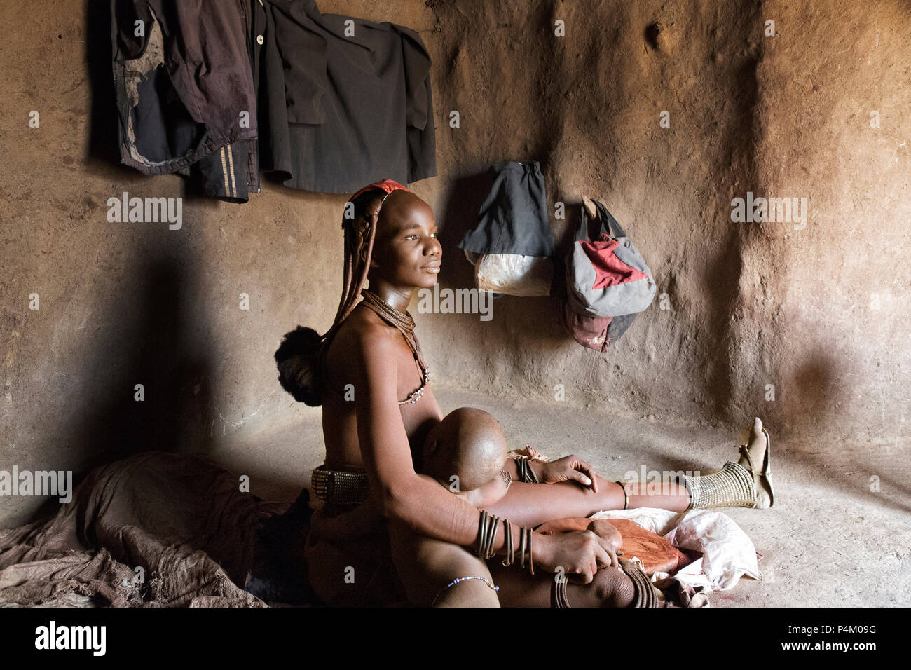 Portrait of a native Himba woman, Namibia - Stock Image