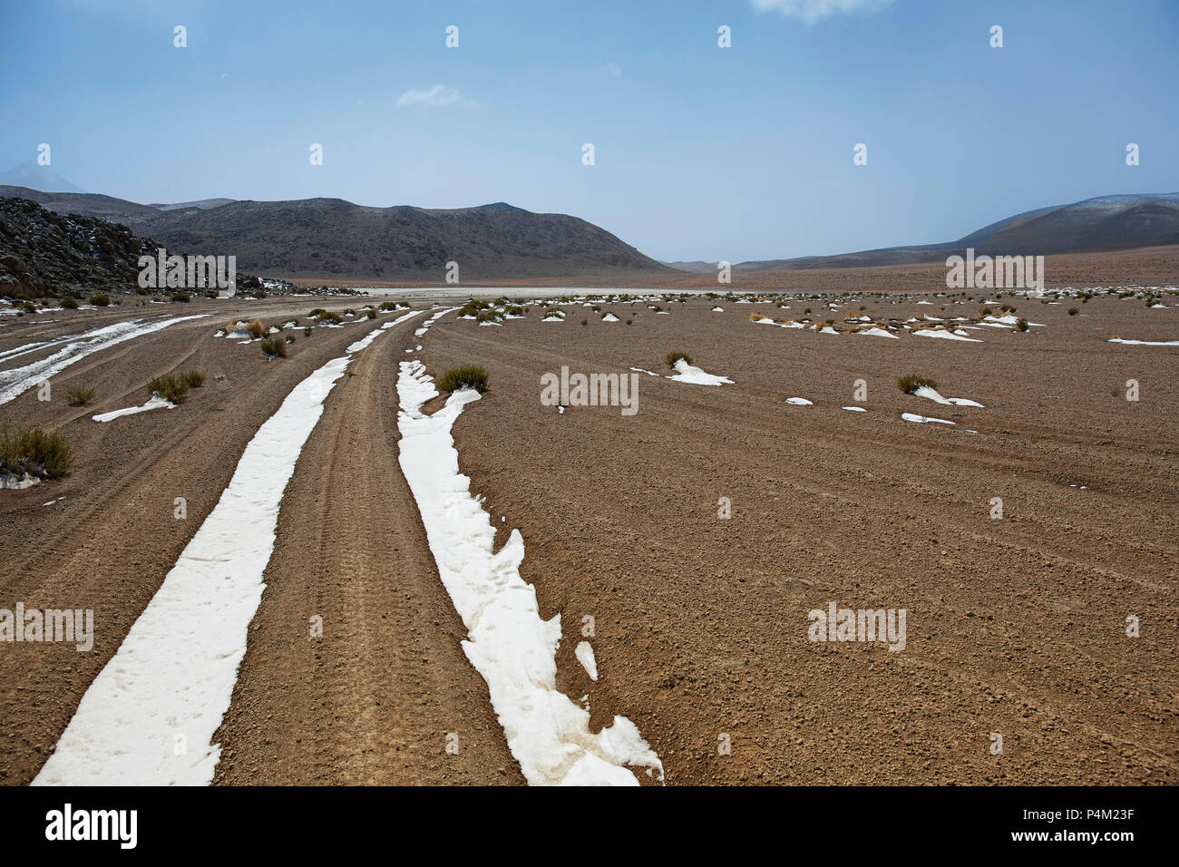 Snow covered track in Farallon de Tara, Atacama Desert, Bolivia - Stock Image