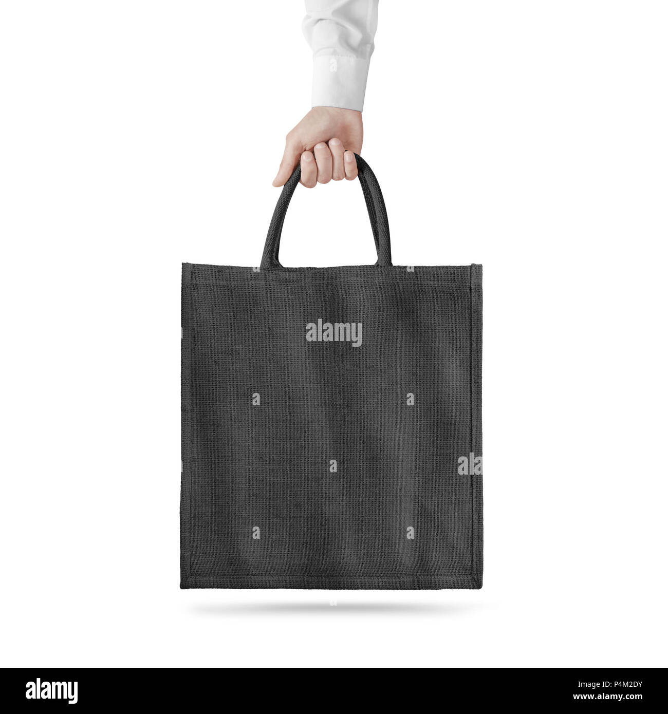 blank black cotton eco bag design mockup isolated holding hand clipping path textile cloth bag mock up template hold arm tote shoe consumer reusab