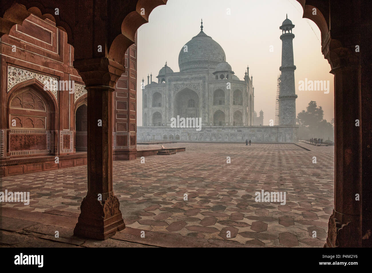 Taj mahal just after sunrise. It can barely be seen due to the high air polution in the Agra area - Stock Image