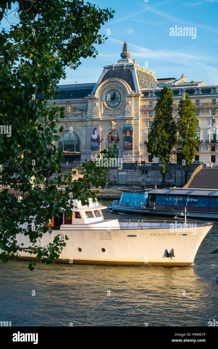 Tourist boat cruising on the Seine river with view of Orsay museum, Paris, IDF, France - Stock Image