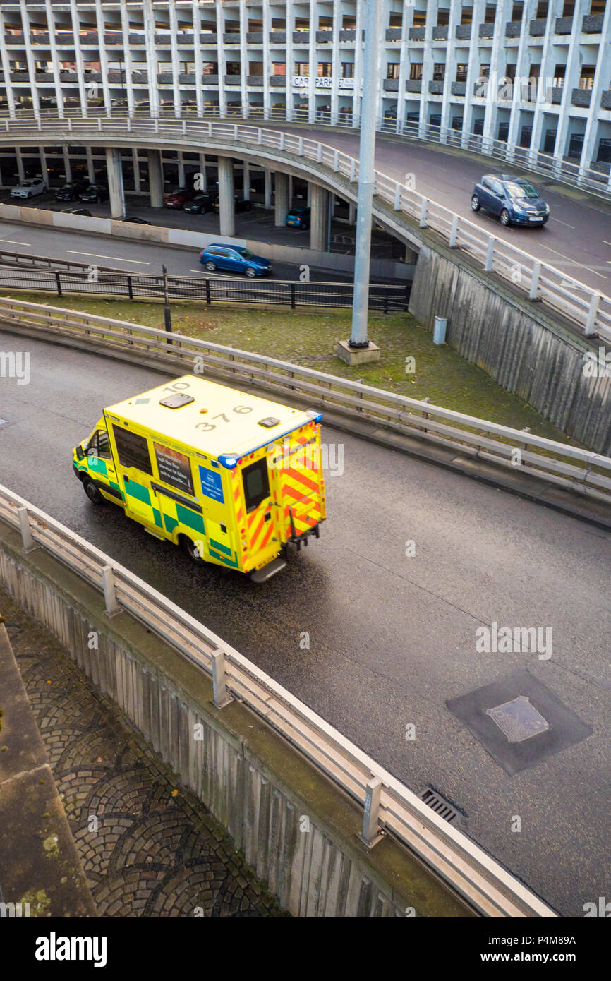 An ambulance o the Central Motorway through Newcastle upon Tyne - Stock Image