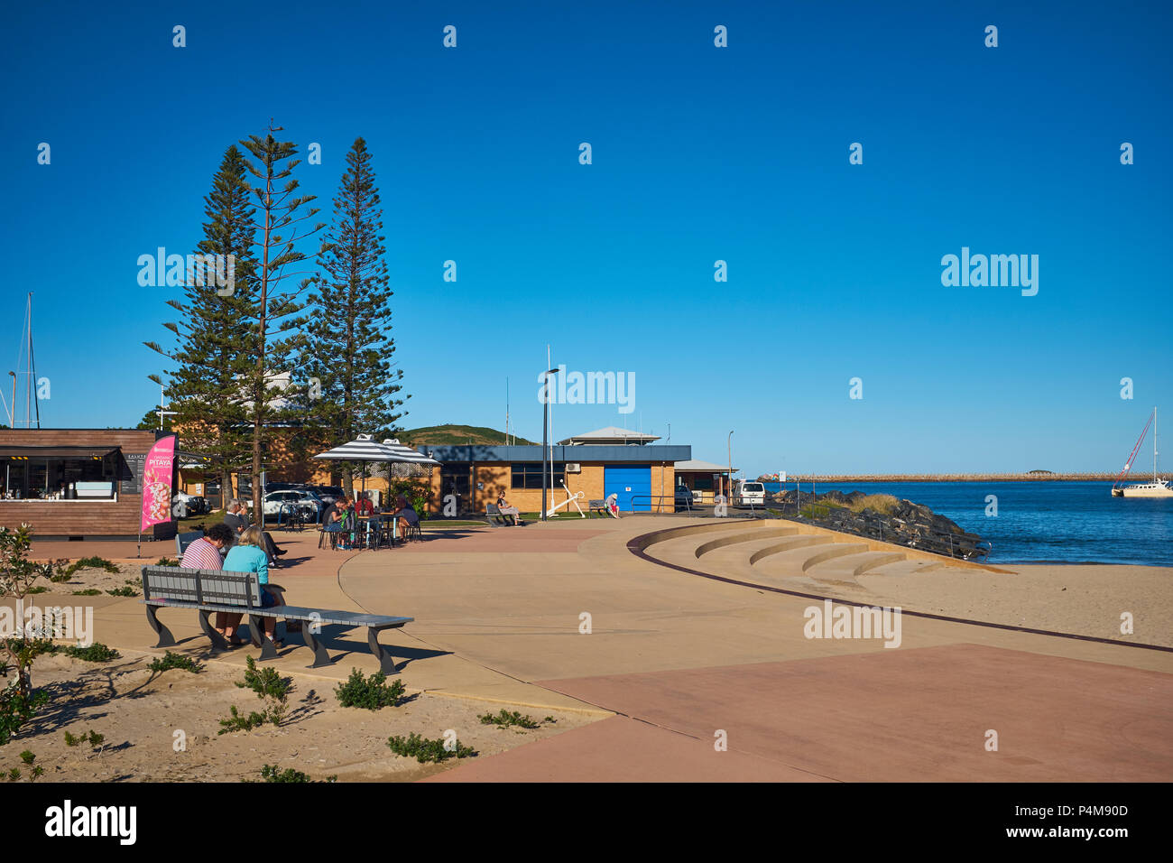 Eating area at Jetty Foreshores Park with a bright cloudless sky, Jetty Beach, Coffs harbour, New South Wales, Australia - Stock Image