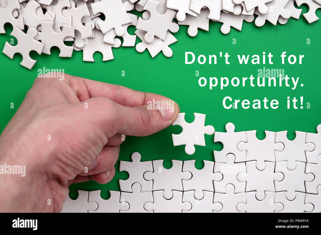 don t wait for opportunity create it the hand folds a white jigsaw