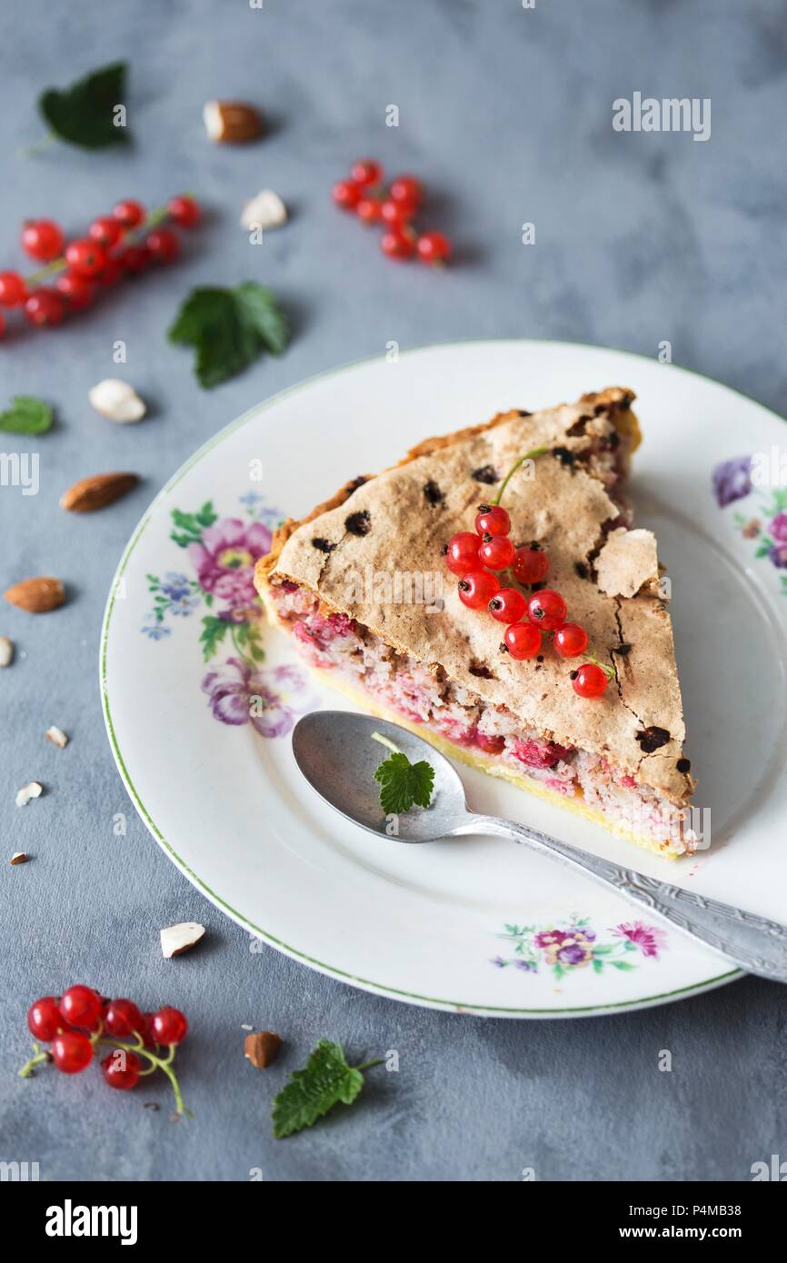 A slice of redcurrant and almond tart Stock Photo