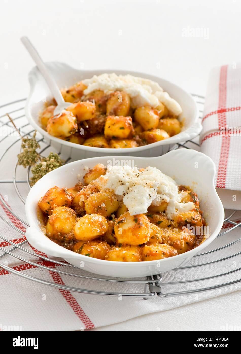 Gratinated gnocchi with ricotta and Pecorino cheese - Stock Image