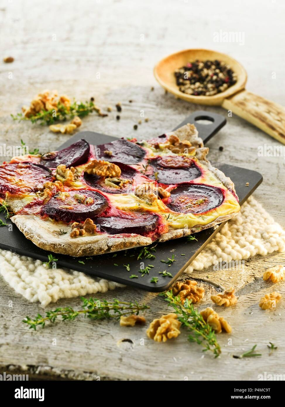 Tarte flambée with beetroot and walnuts - Stock Image