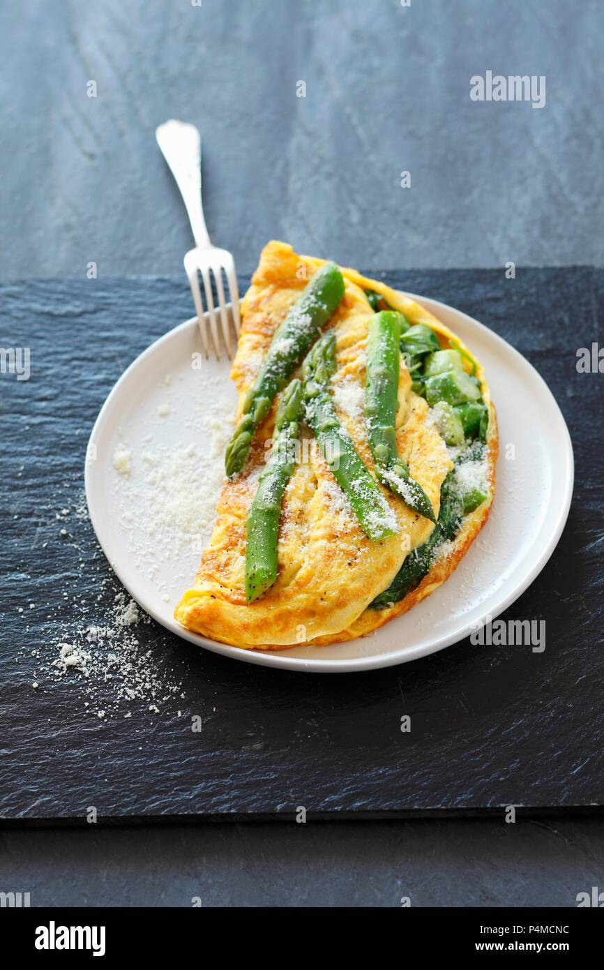 A spinach and asparagus omelette - Stock Image