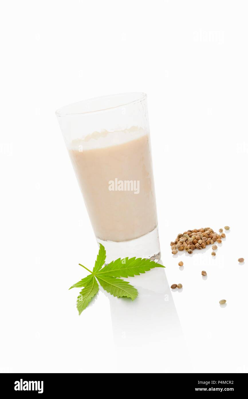 A glass of hemp milk on a white surface Stock Photo