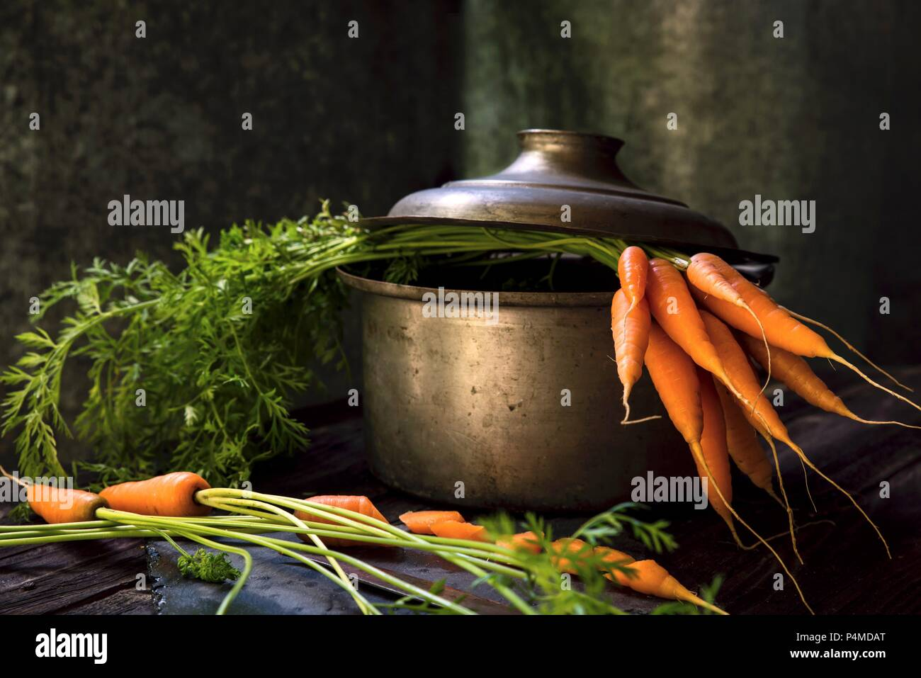 Fresh carrots in a cooking pot - Stock Image