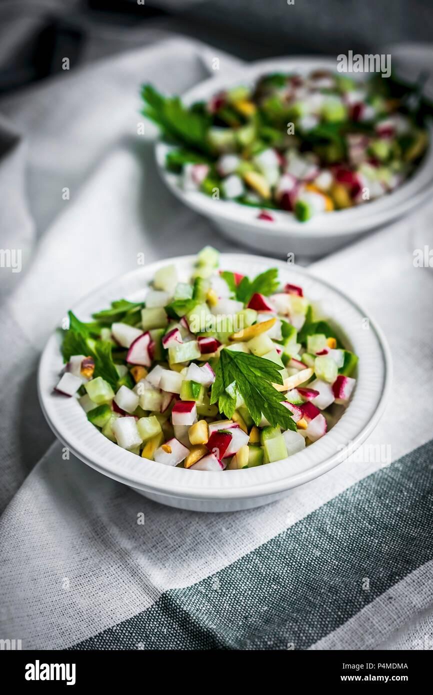 Vegetable salad on a tea towel - Stock Image