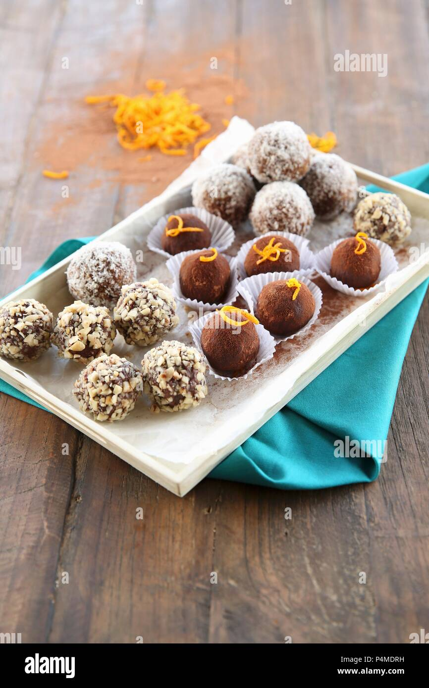 A plate of vegan bliss balls on a blue napkin - Stock Image