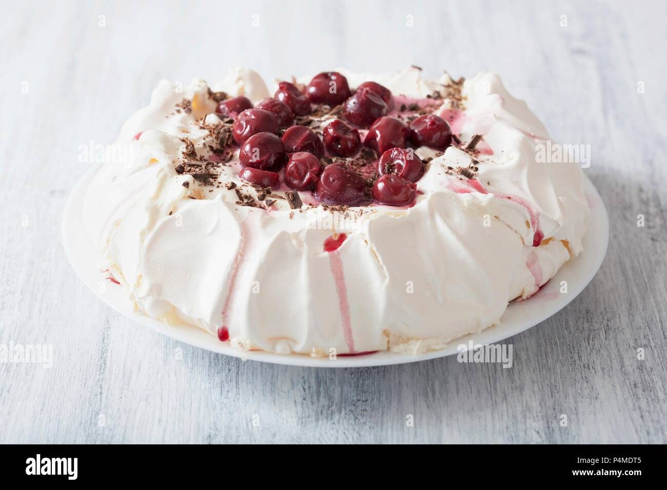 Pavlova with cherries and chocolate - Stock Image