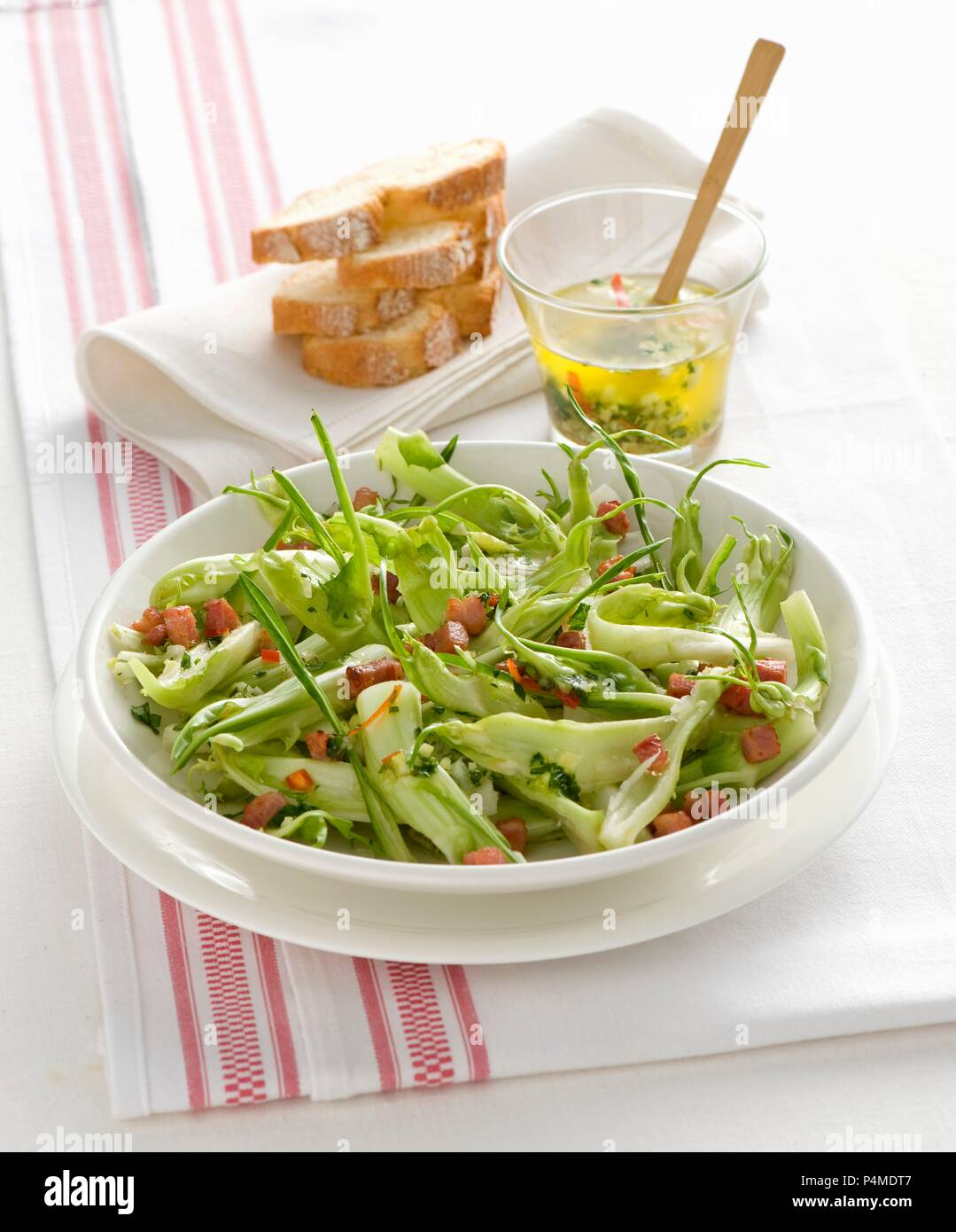 Chicory salad with bacon - Stock Image