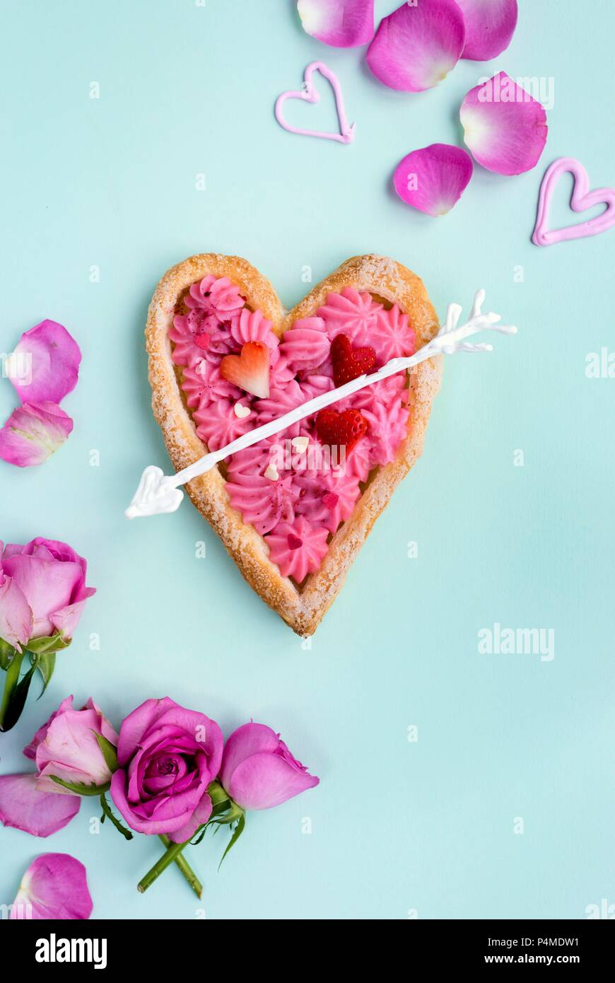 Heart shaped puff pastry tart filled with rose pastry cream for Valentine's Day - Stock Image