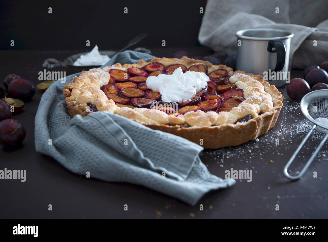 A plum cake with vegan soya whipped cream - Stock Image