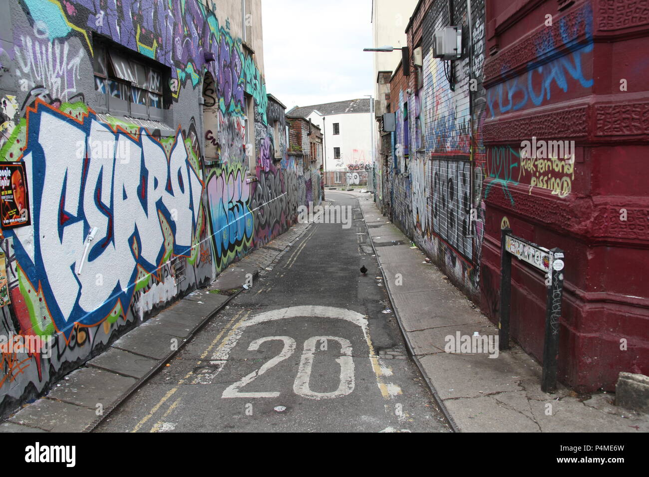 A graffiti covered side street in Stokes Croft, Bristol, England. - Stock Image