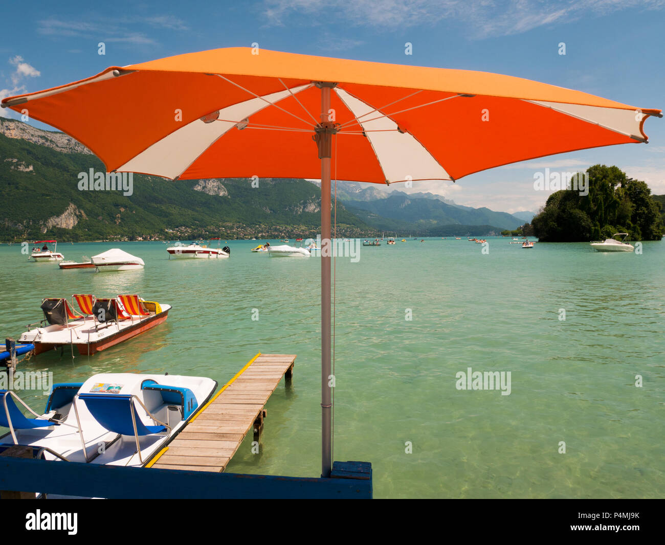 parasol and view on Lake Annecy, France - Stock Image