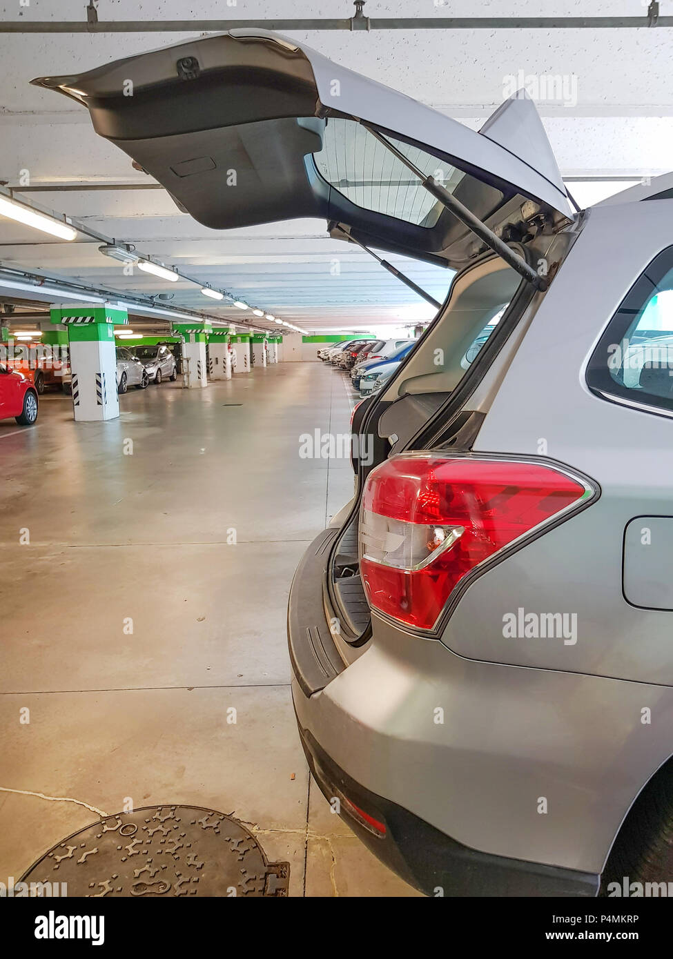 Hatchback car, open car trunk in parking car under shopping mall. - Stock Image
