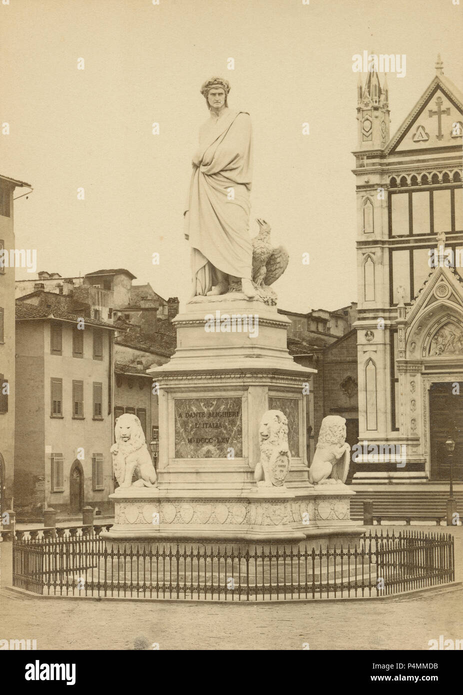 Antique circa 1880 photograph, the statue of Dante Alighieri in Piazza Santa Croce, next to Basilica of Santa Croce, Florence, Italy. It was built in 1865 by Italian sculptor Enrico Pazzi. SOURCE: ORIGINAL PHOTOGRAPH - Stock Image