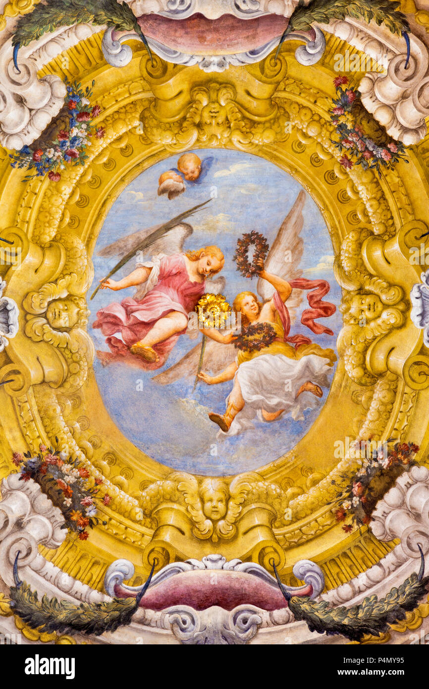 PARMA, ITALY - APRIL 17, 2018: The fresco of angels with the symbols of the martyrdom on the wault of church Chiesa di Santa Lucia - Stock Image