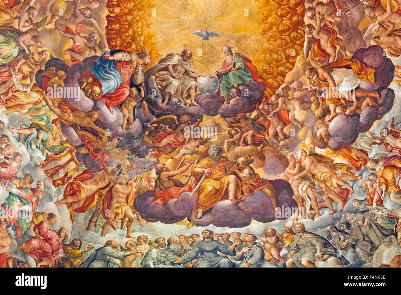 PARMA, ITALY - APRIL 16, 2018: Fresco of Holy Trinity and saints in the glory in cupola of Chiesa di Santa Maria del Quartiere by P. A. Bernabei. Stock Photo