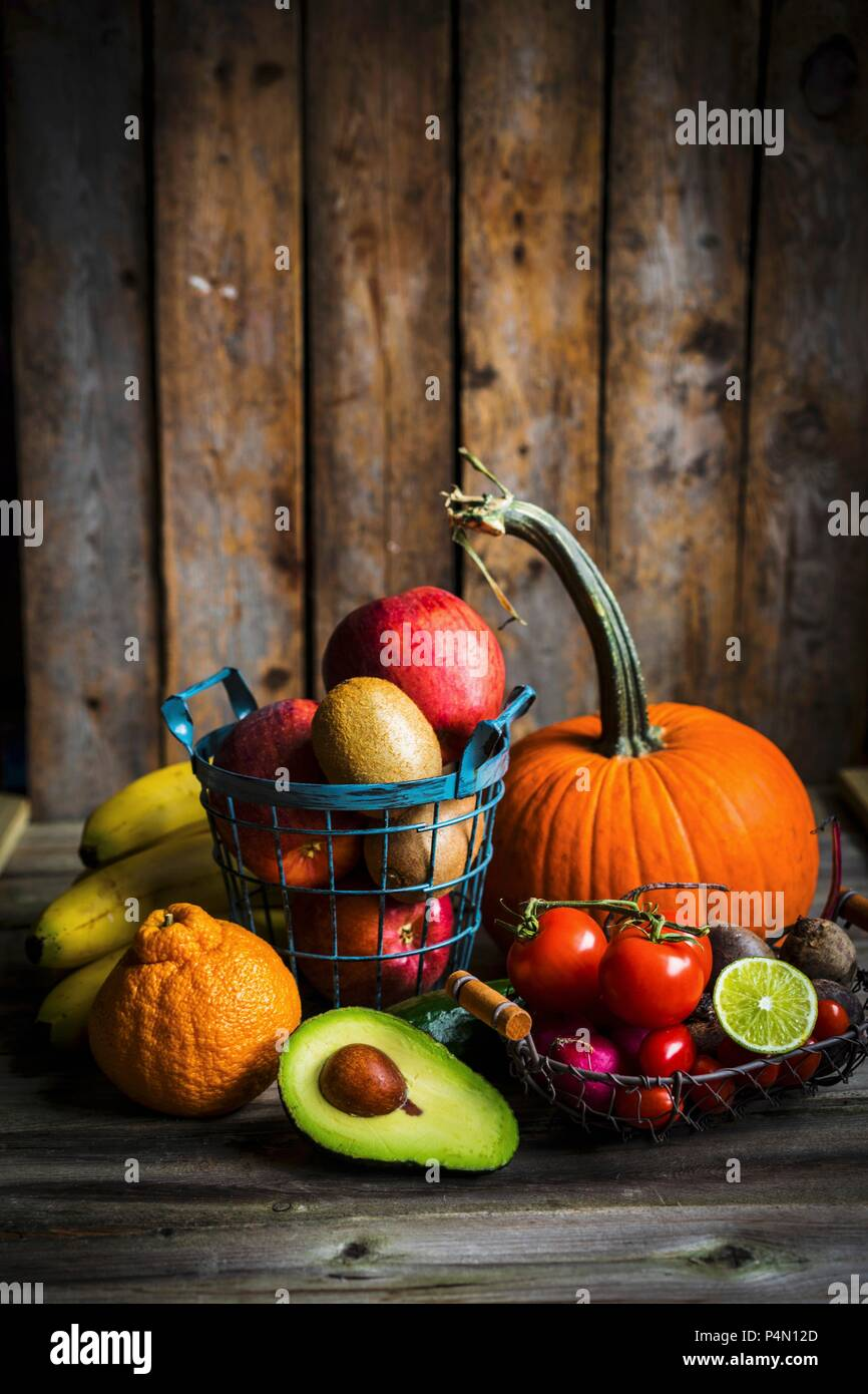 Fruit and vegetables on a wooden surface - Stock Image