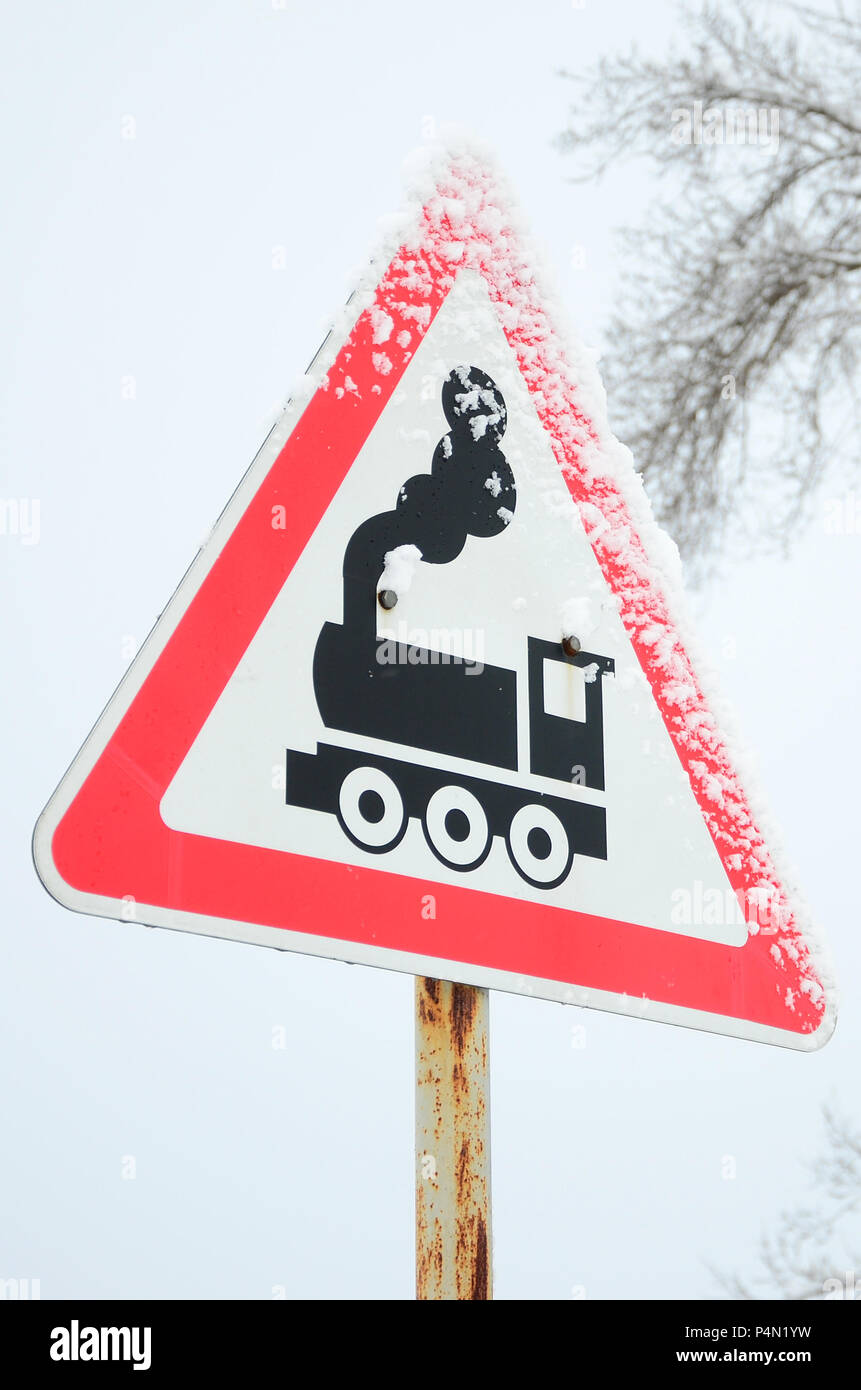 Railway crossing without barrier  A road sign depicting an