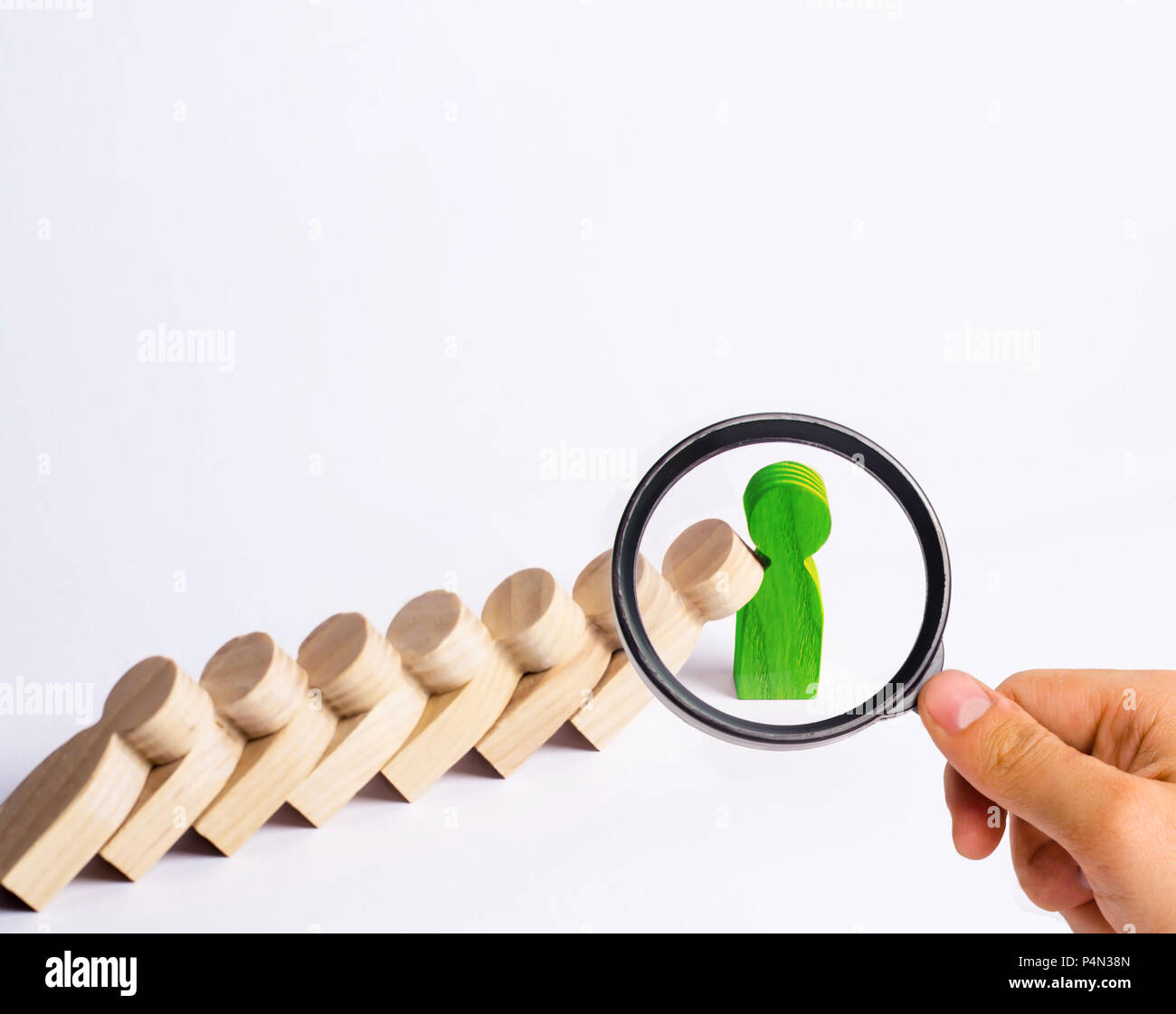 People in line fall like dominoes. Green man stops the fall of people as dominoes. The concept of durability and strength, business ideas. Willpower,  - Stock Image