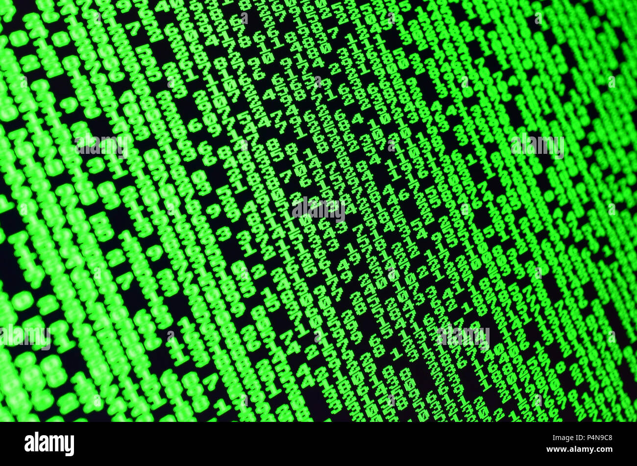 Macro of password selection on the monitor of the office computer. The concept of hacking the protection of a personal data keeper. The stream of supp - Stock Image