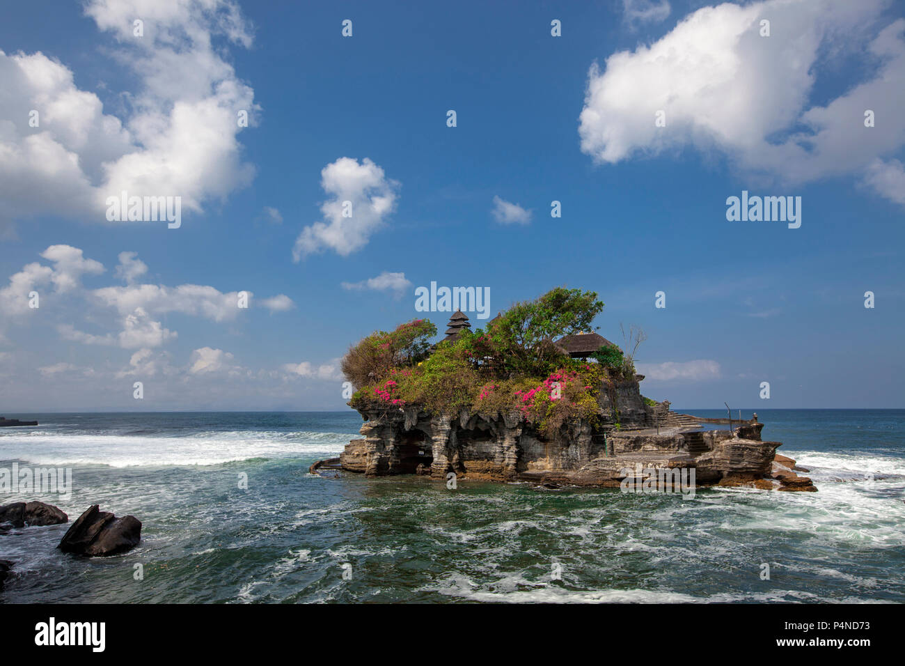 Tanah Lot Temple in Bali Indonesia - nature and architecture background - Stock Image