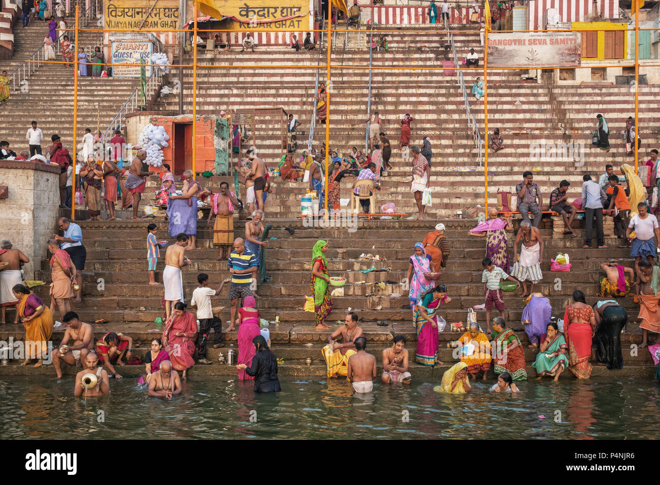 Unidentified people taking ritual bath in the river Gangain the holy city of Varanasi, India. Stock Photo