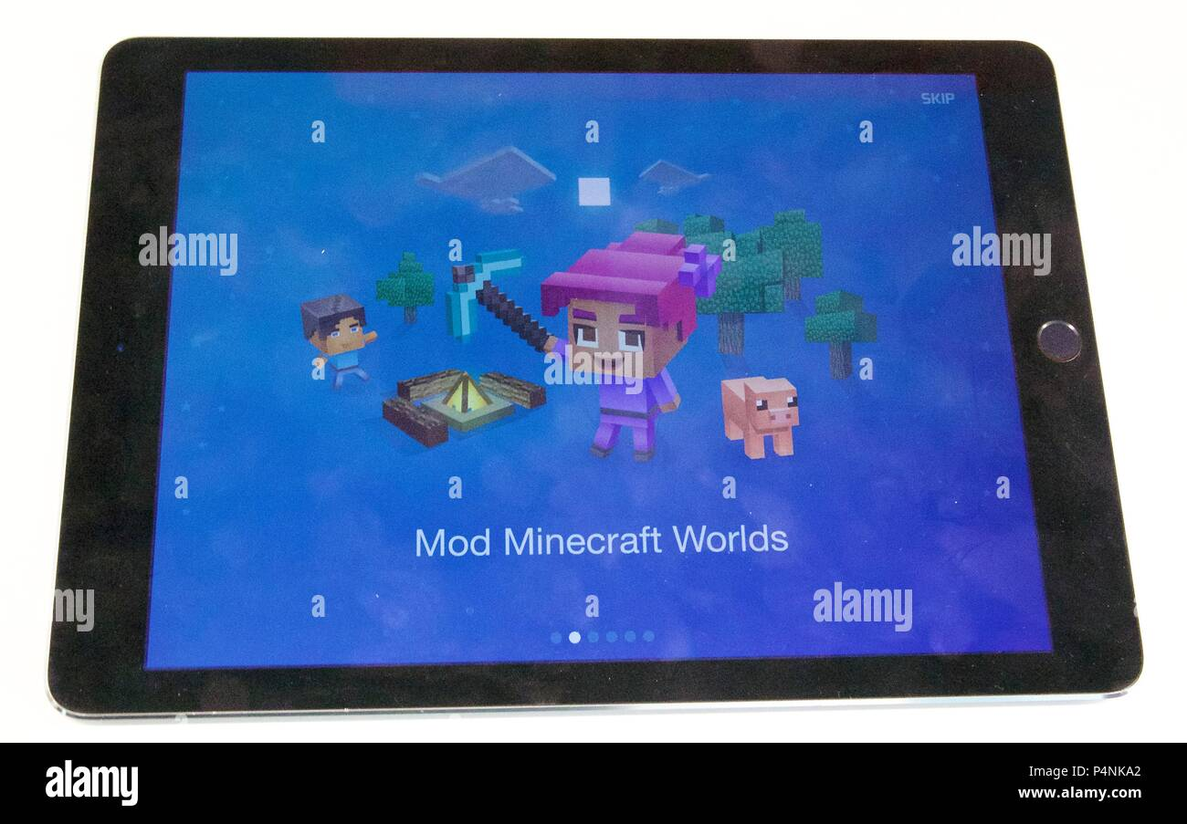 The intro screen which says 'Mod Minecraft Worlds' for Tynker: Coding for kids app on an iPad Air - Stock Image