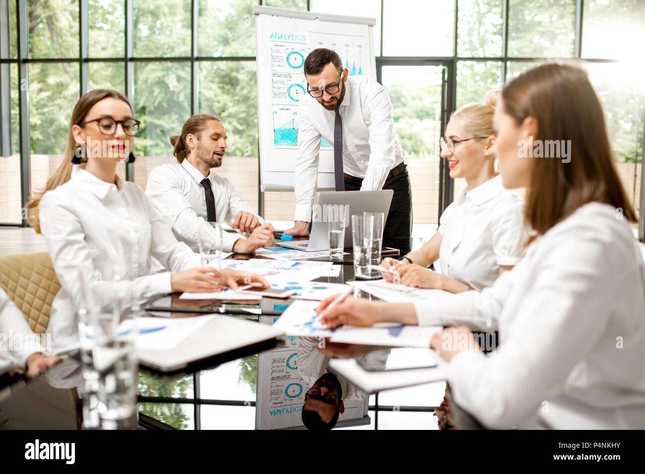 Business people during a conference indoors - Stock Image