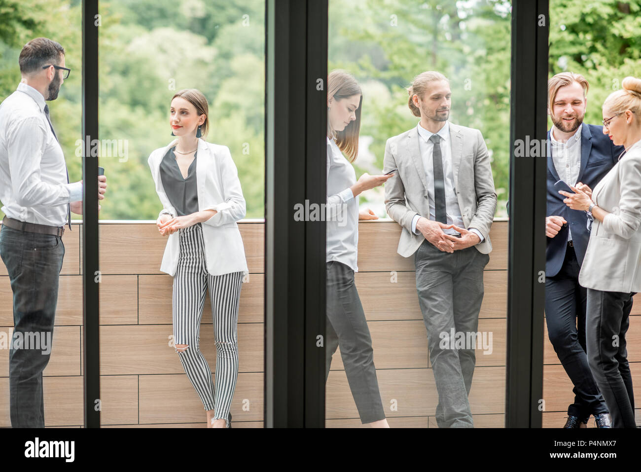 Business people on the office balcony during a break - Stock Image