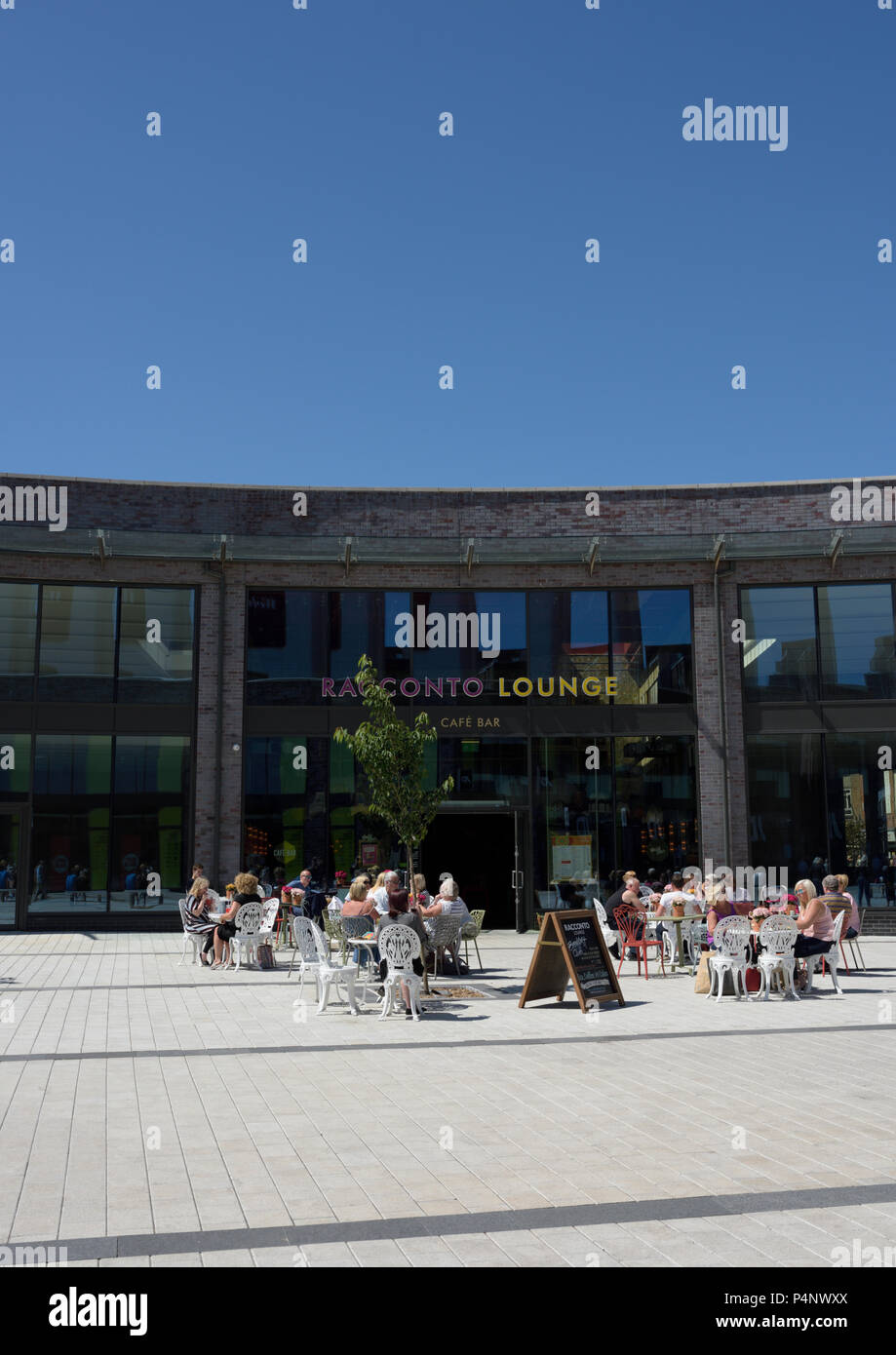 Racconto lounge, bar restaurant with people sitting outside at tables in the sunshine in bury lancashire uk - Stock Image