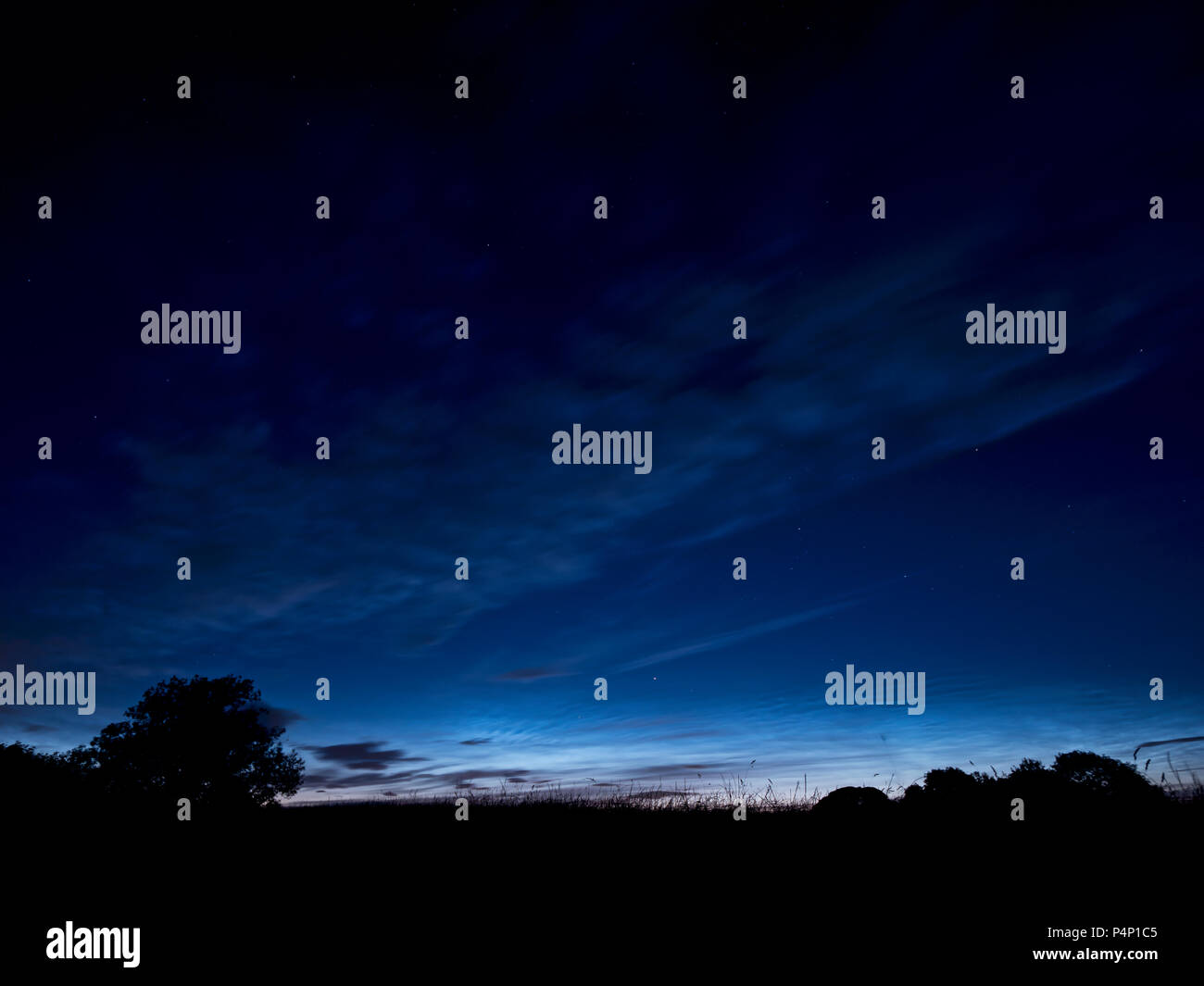 Weather UK: Amazingly bright sunlight on the horizon in the night sky over Ashbourne, Derbyshire after the Summer solstice taken after 1am on Saturday 23rd June 2018 taken facing due North East towards The Peak District National Park Credit: Doug Blane/Alamy Live News - Stock Image