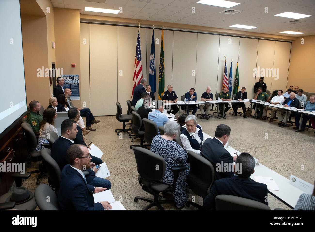 Seated between flags, U.S. Senators Ted Cruz, left, and John Cornyn listen as federal and Texas officials and stakeholders meet in a round-table discussion of the immigration crisis hitting the Texas-Mexico border. Confusion and public outrage reigned regarding the Trump administration's policy of separating undocumented immigrant parents from their children after crossing into the U.S. from Mexico. - Stock Image