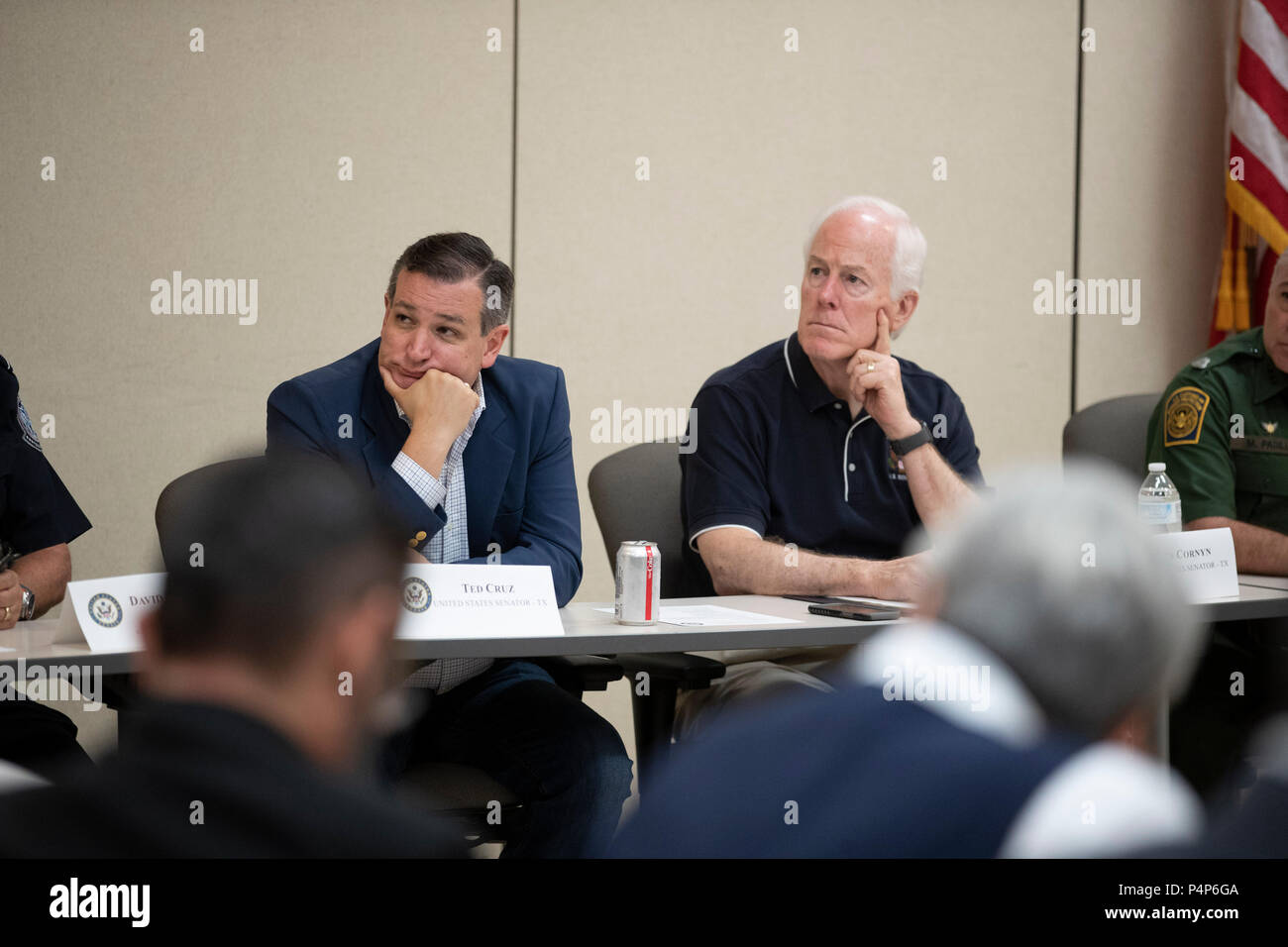 U.S. Senators Ted Cruz, left, and John Cornyn listen as federal and Texas officials and stakeholders meet in a round-table discussion of the immigration crisis hitting the Texas-Mexico border. Confusion and public outrage reigned regarding the Trump administration's policy of separating undocumented immigrant parents from their children after crossing into the U.S. from Mexico. - Stock Image