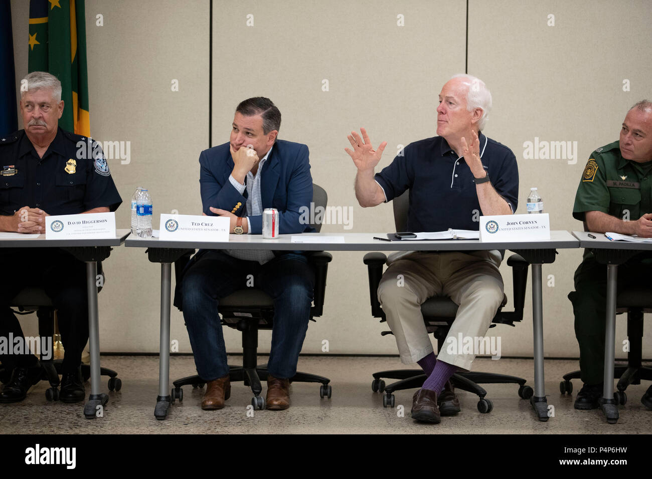 U.S. Sen. John Cornyn speaks while Sen. Ted Cruz and others listen as federal and Texas officials and stakeholders meet in a round-table discussion of the immigration crisis hitting the Texas-Mexico border. Confusion and public outrage reigned regarding the Trump administration's policy of separating undocumented immigrant parents from their children after crossing into the U.S. from Mexico. - Stock Image