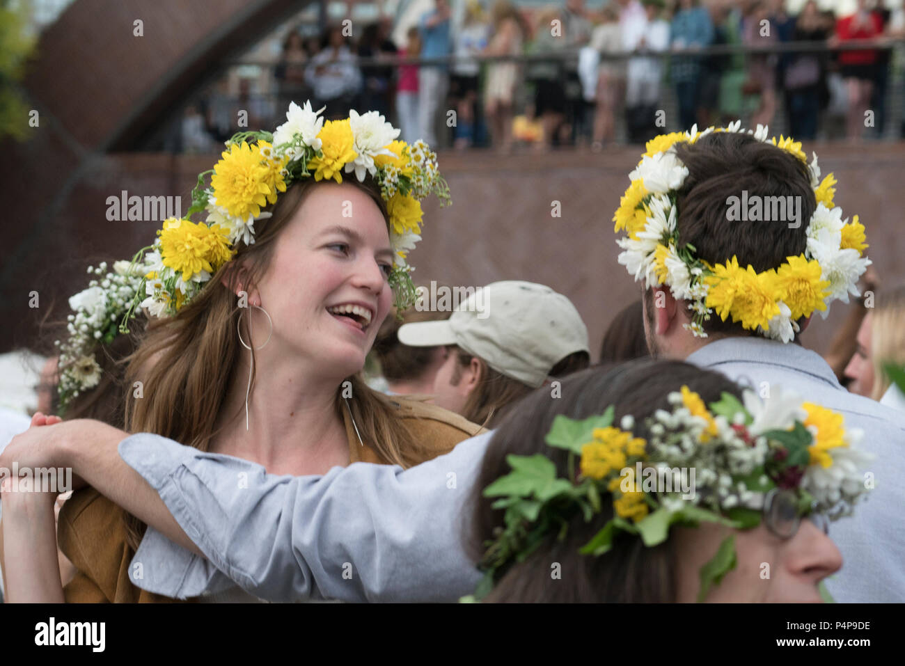 New York, USA. 22nd June, 2018. The Swedish Midsummer Festival in Battery Park City's Wagner Park is the largest in New York City and the third largest in the world. Thousands of people attend to dance around the maypole, listen to fiddle music, eat Swedish food and make wreaths of flowers for their hair. This year, the Dalarnas Fiddlers Association from Sweden joined Paul Dahlin and fiddlers from the American Swedish Institute in Minneapolis to play for the festival. (Credit: Terese Loeb Kreuzer/Alamy Live News) Stock Photo