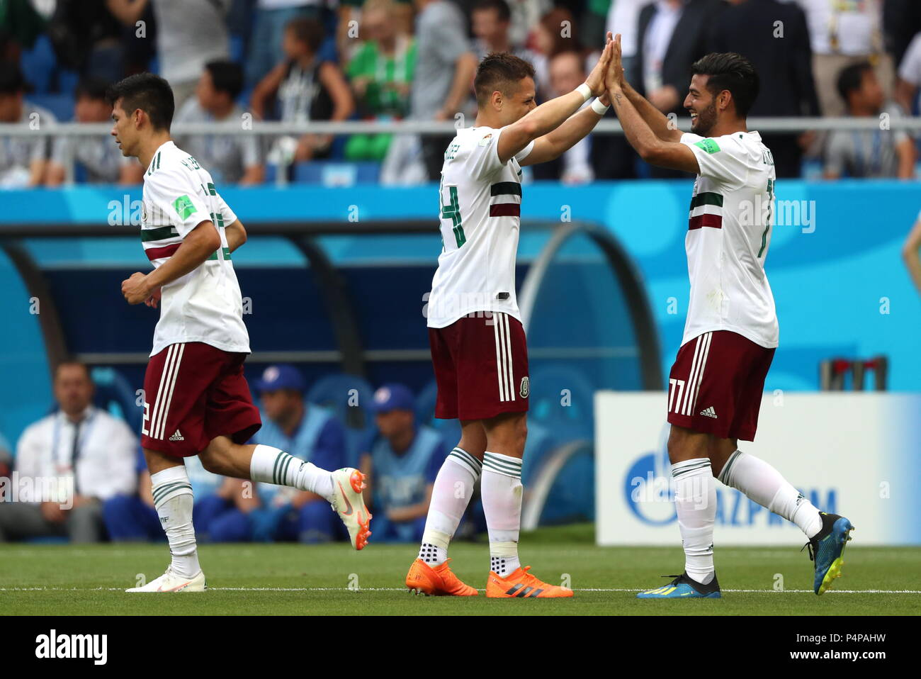 Rostov On Don, Russia. 23rd June, 2018. ROSTOV-ON-DON, RUSSIA - JUJNE 23, 2018: Mexico's Hirving Lozano, Javier Hernandez, and Carlos Vela (L-R) celebrate scoring in their 2018 FIFA World Cup Group F football match against South Korea at Rostov Arena Stadium. Sergei Savostyanov/TASS Credit: ITAR-TASS News Agency/Alamy Live News - Stock Image