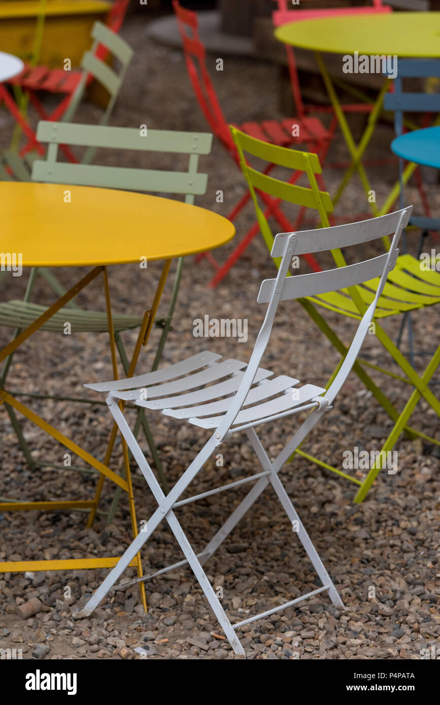 brightly coloured shabby chic garden furniture. - Stock Image