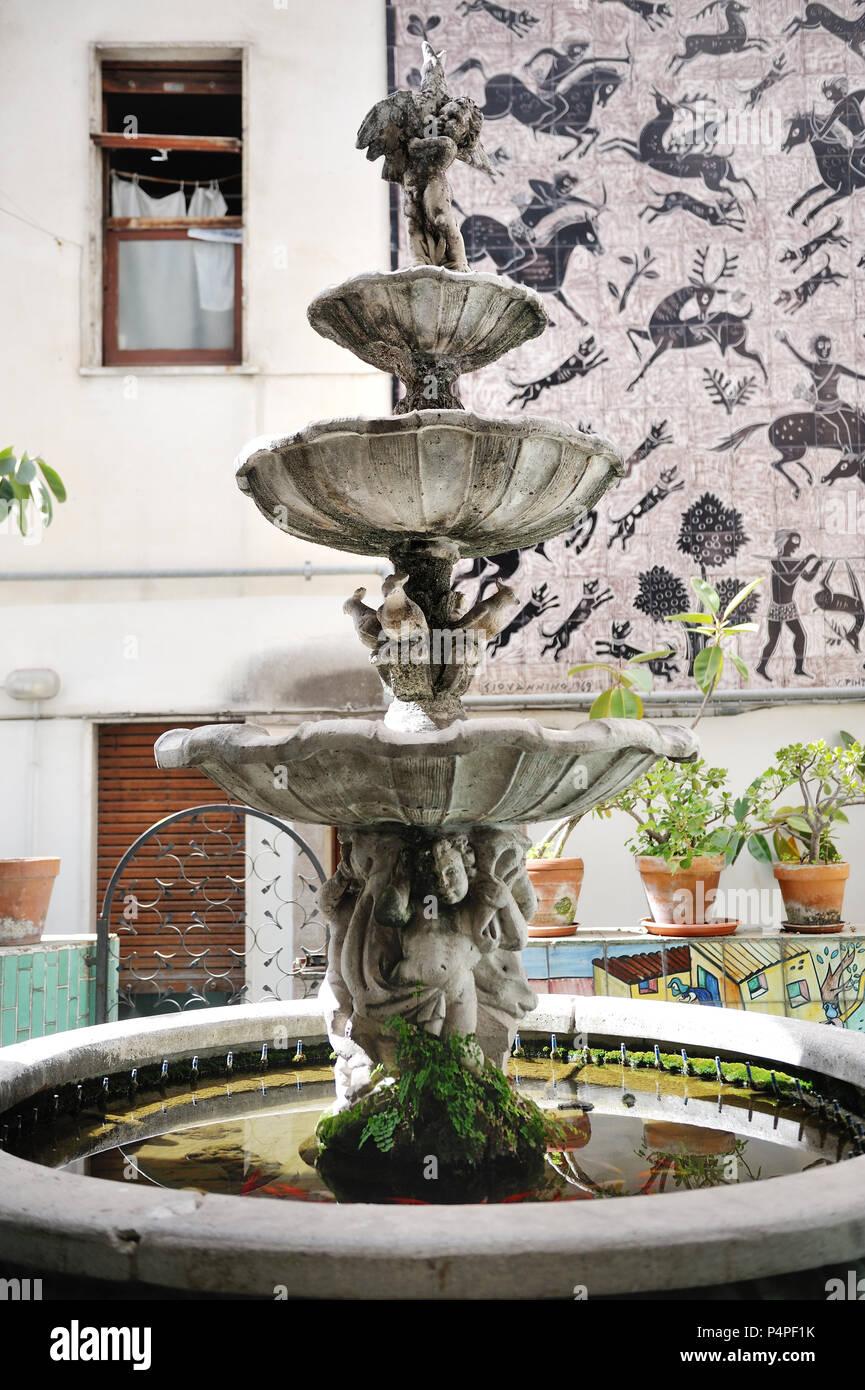 VIETRI SUL MARE, ITALY - April 27, 2018 Decorative fountain in the Italian courtyard in Amalfi Coast Stock Photo