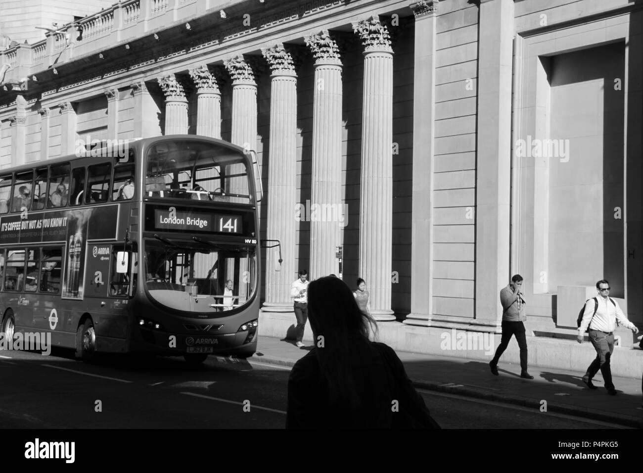 Commuters and office workers scurrying to work past the entrance of The Bank of England in the financial district of London, England, UK, PETER GRANT - Stock Image