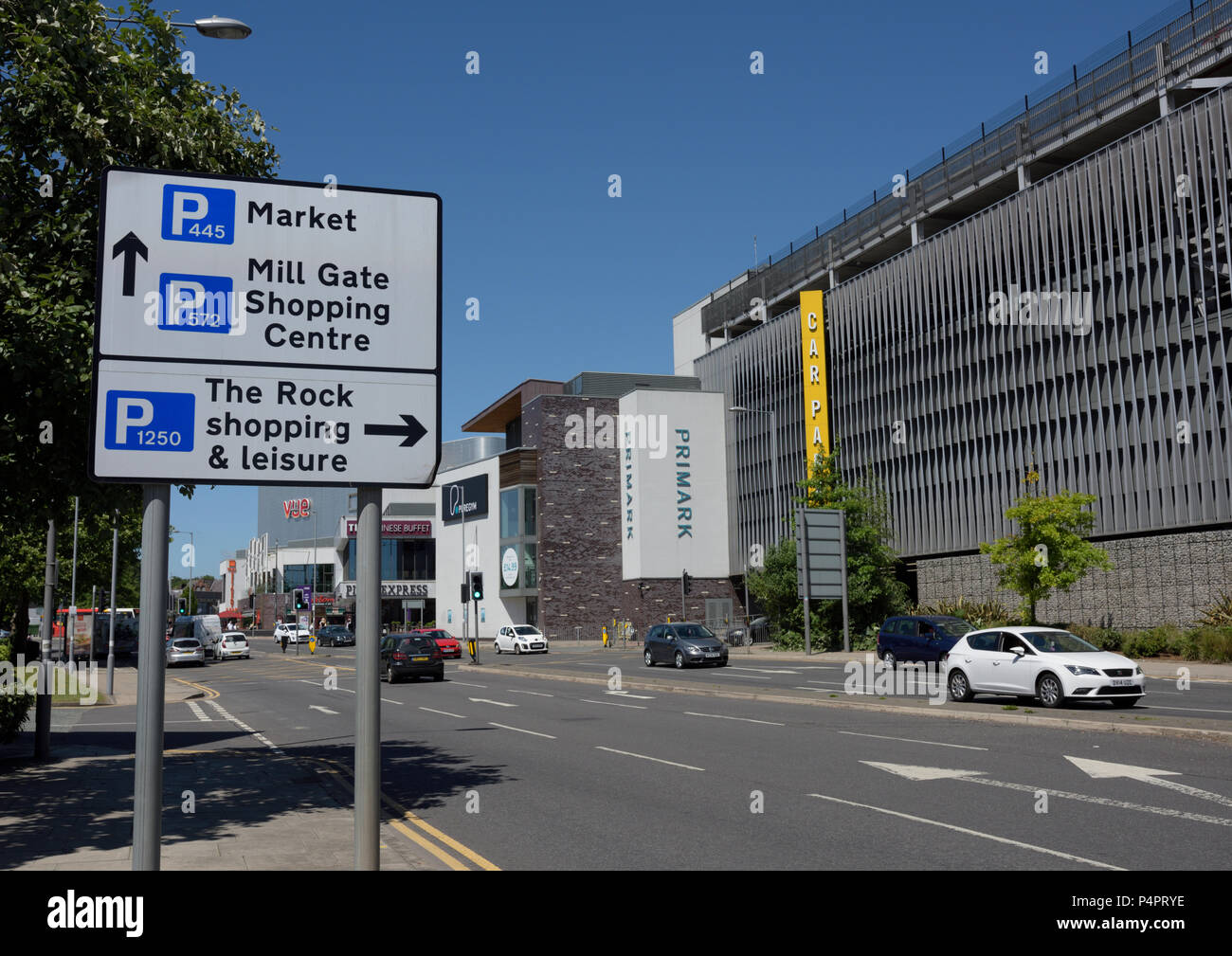 Road sign with directions for car parking at the rock shopping and leisure,  millgate  shopping centre and market, next to multi storey car park - Stock Image