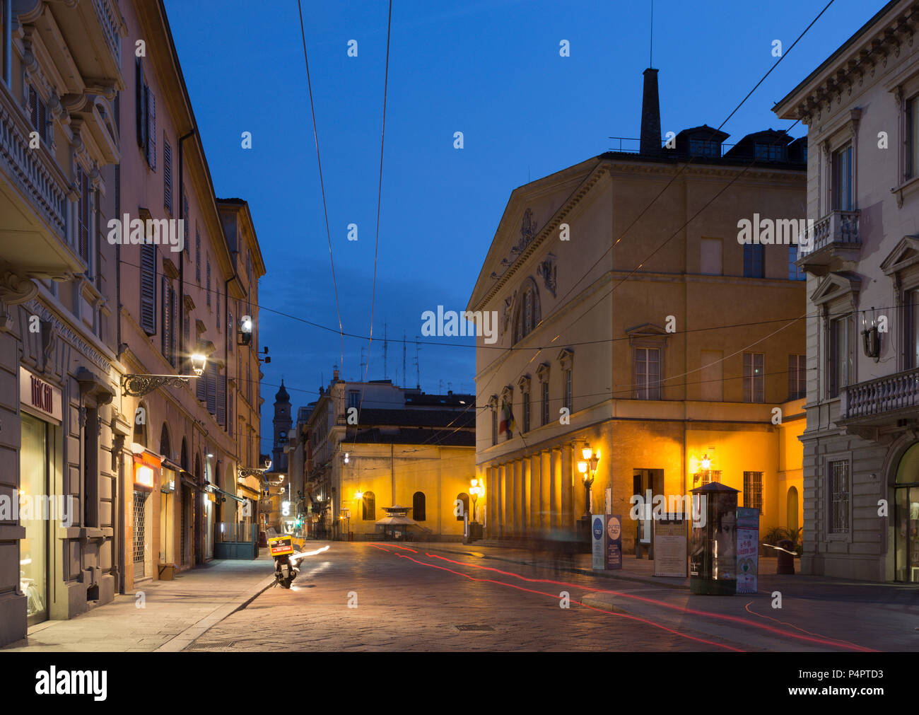 PARMA, ITALY - APRIL 17, 2018: The street of the old town at dusk and the Teatro Regio theater. - Stock Image