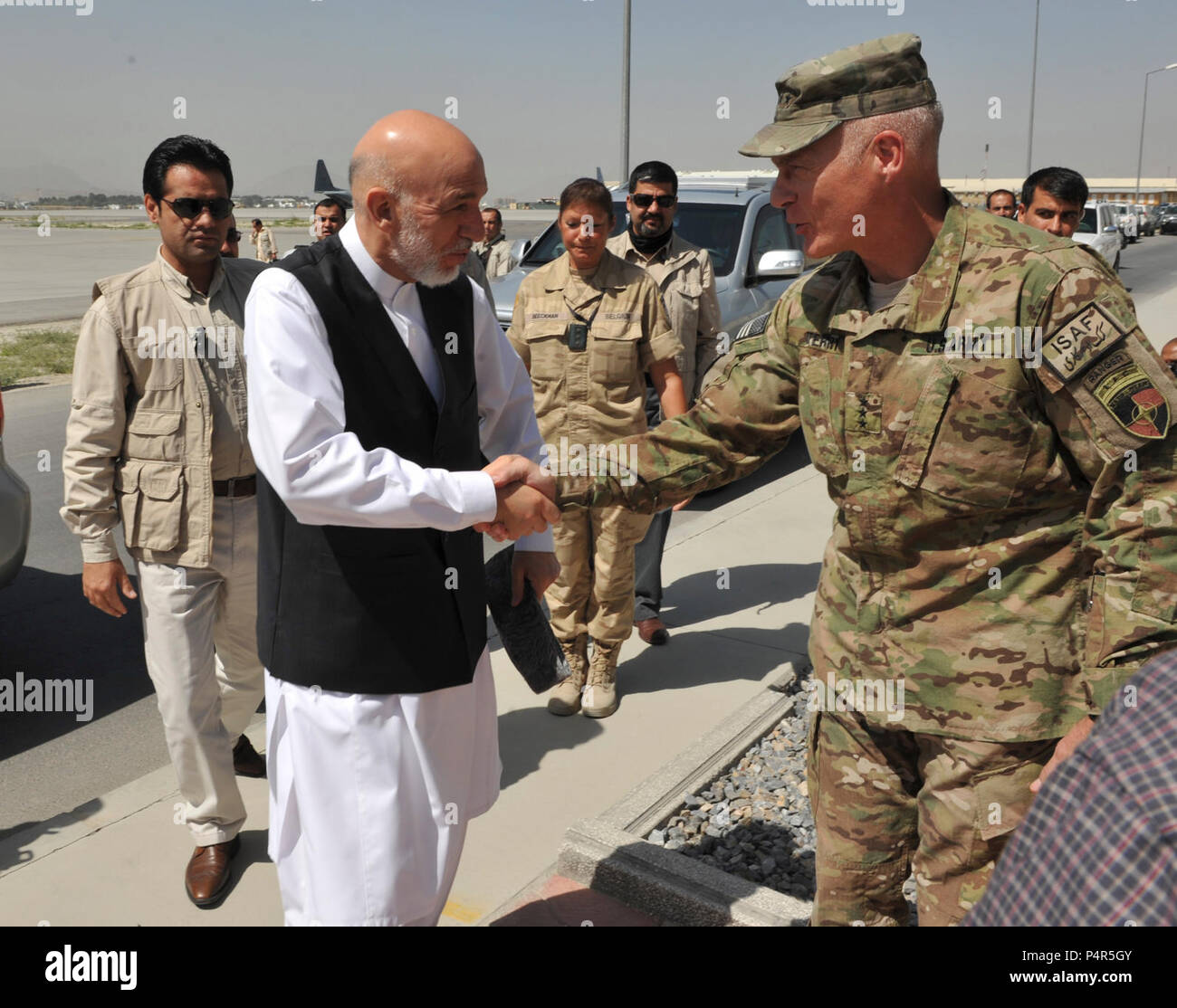 U.S. Army Lt. Gen. James L. Terry, right, the commander of the International Security Assistance Force Joint Command, greets Afghan President Hamid Karzai on the flight line at Kabul International Airport in Kabul province, Afghanistan, Aug. 21, 2012. Stock Photo